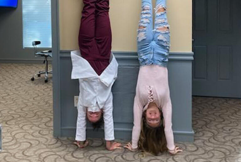 2 young girls doing hand stands