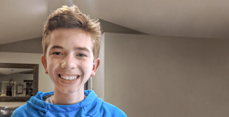 Boy smiling with straight teeth