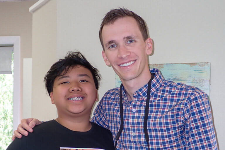 Doctor smiling with a patient who has braces