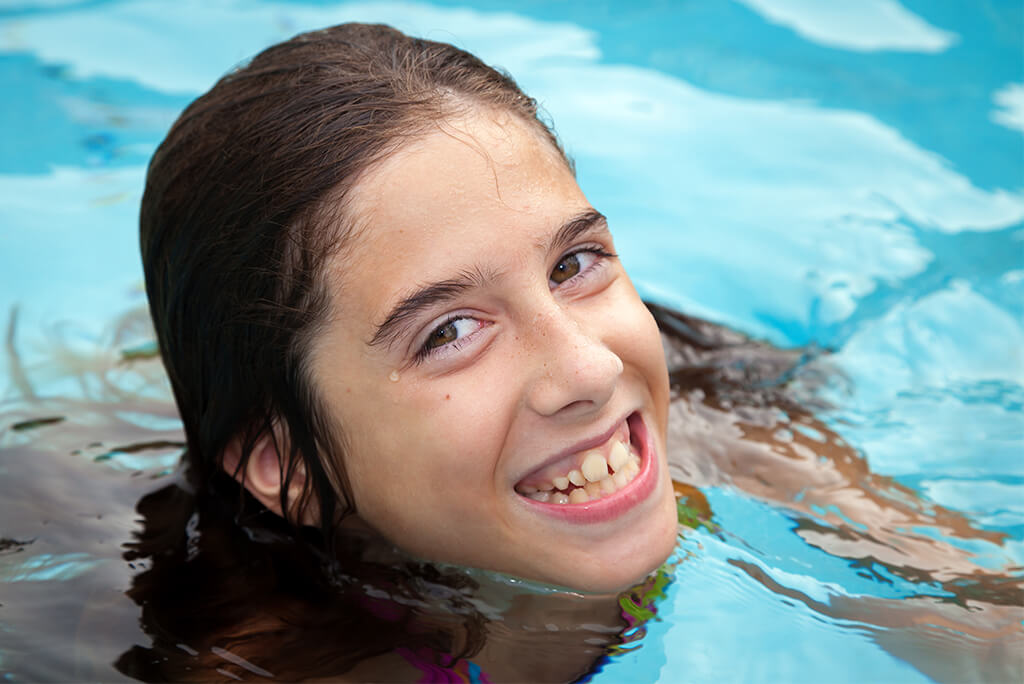 Girl smiling in a pool